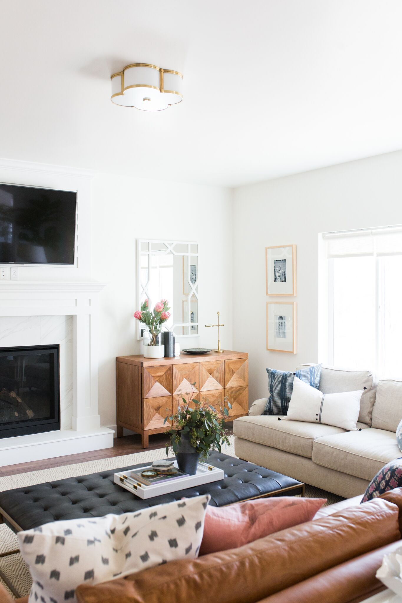 White love seat beside brown couch