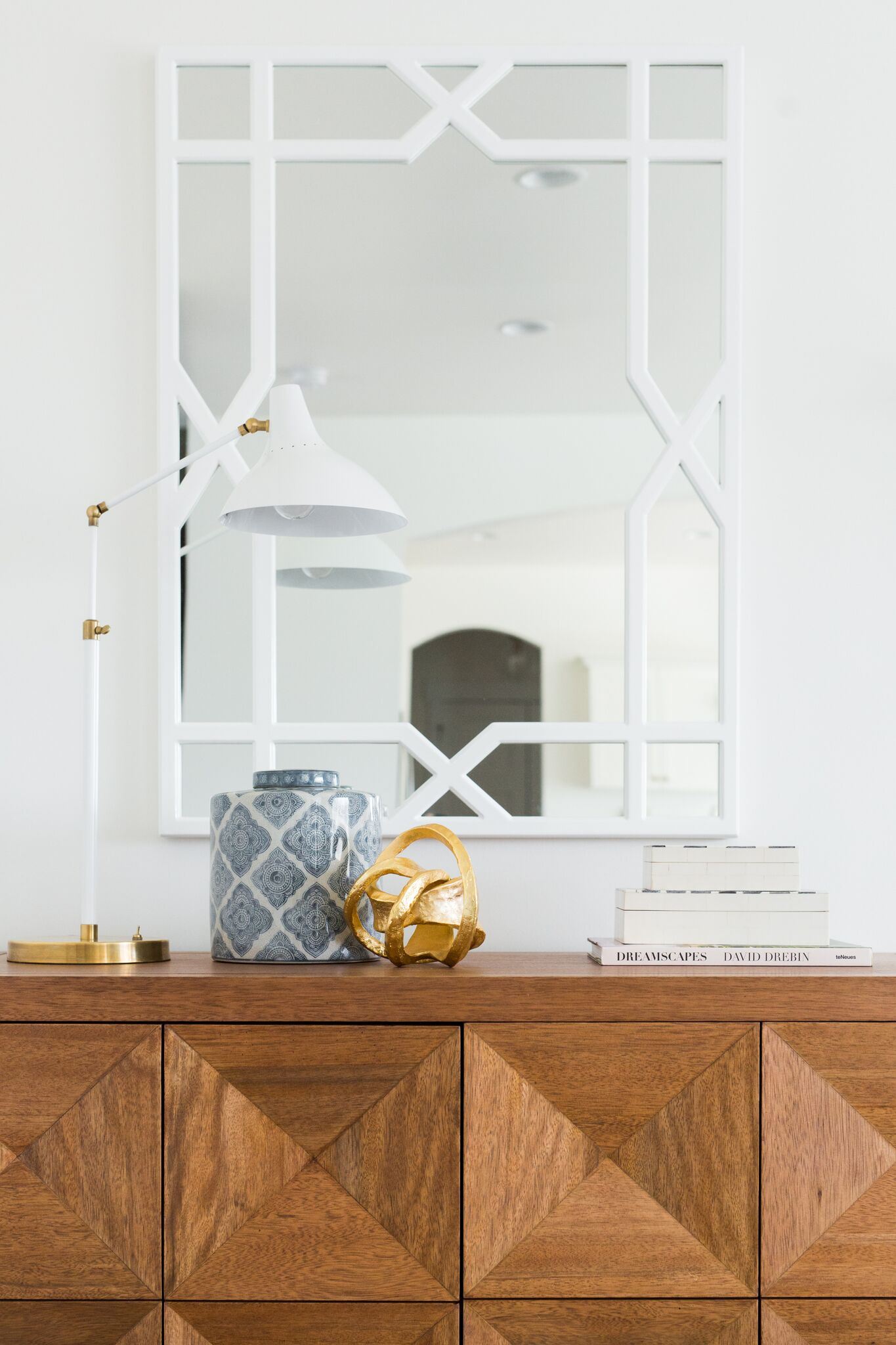Vase and pictures atop wooden hutch