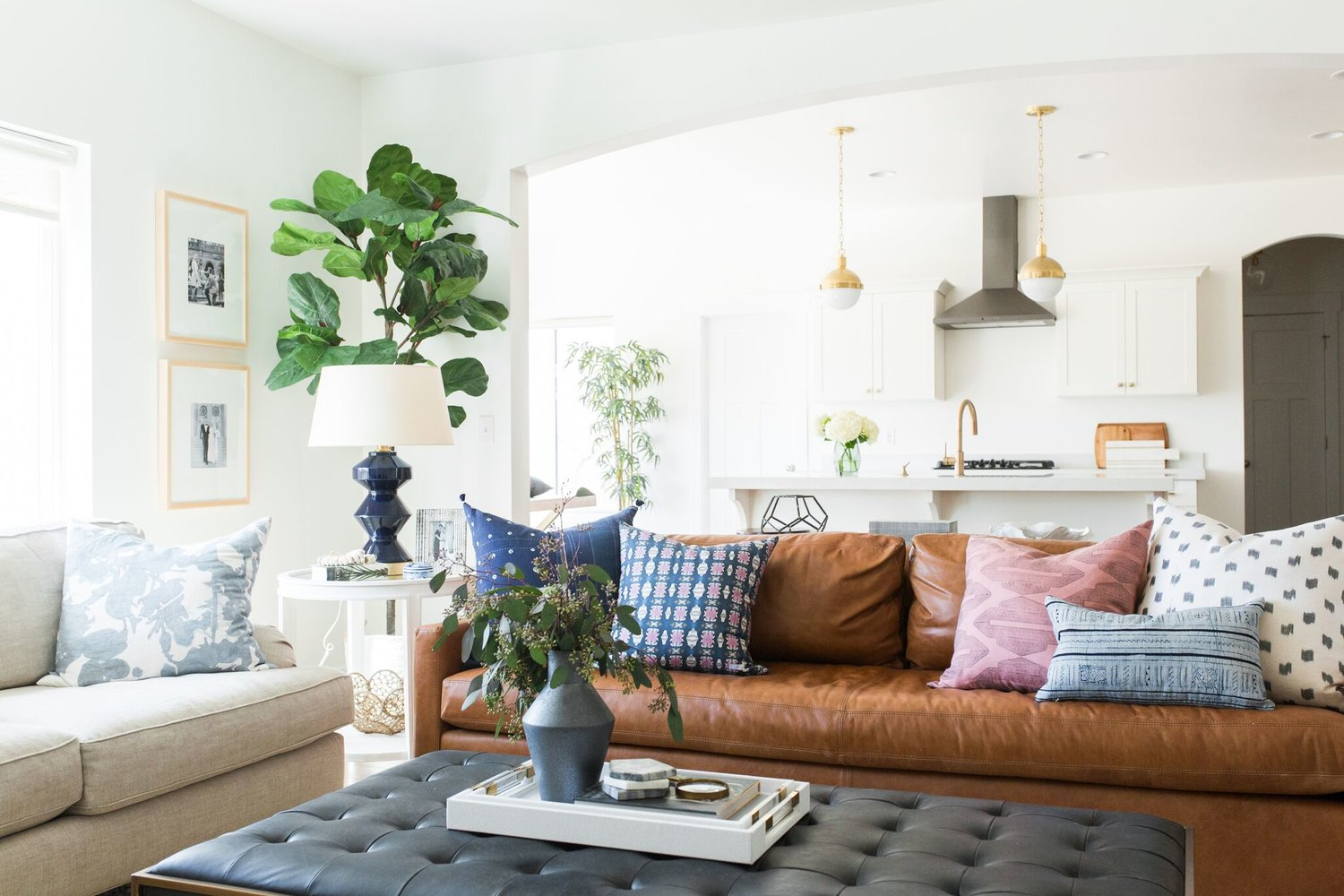 Black coffee table with white and brown couch