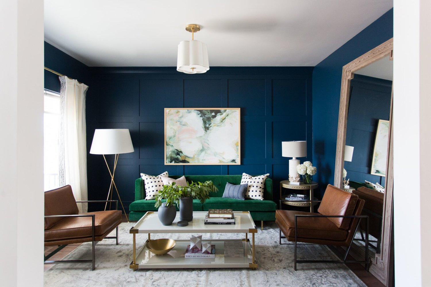 Navy formal room with brown furniture
