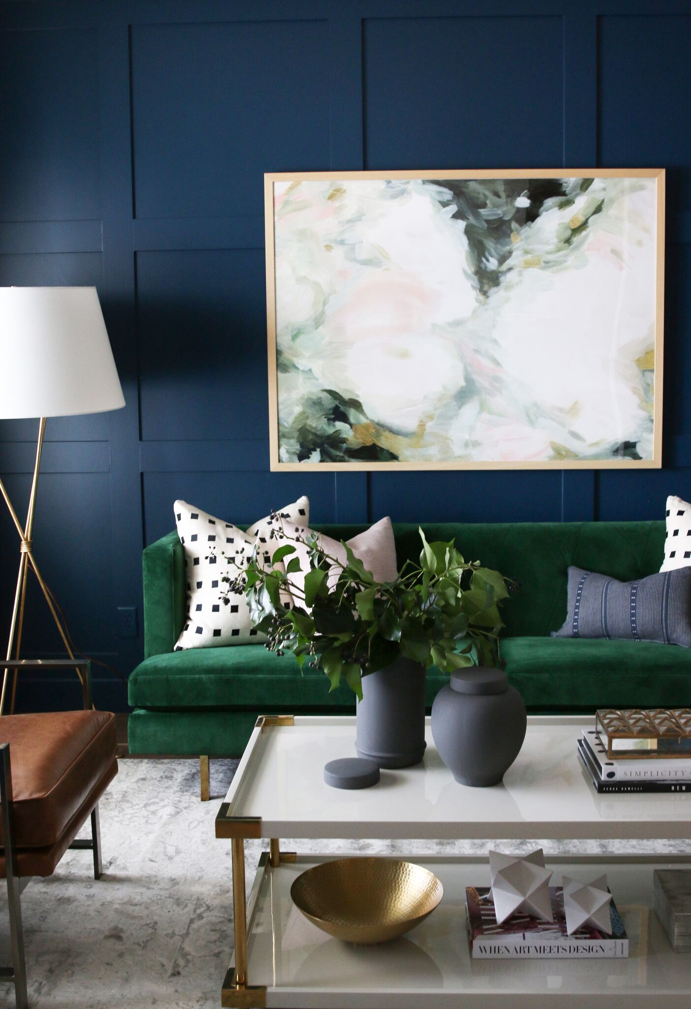 White coffee table in front of green couch