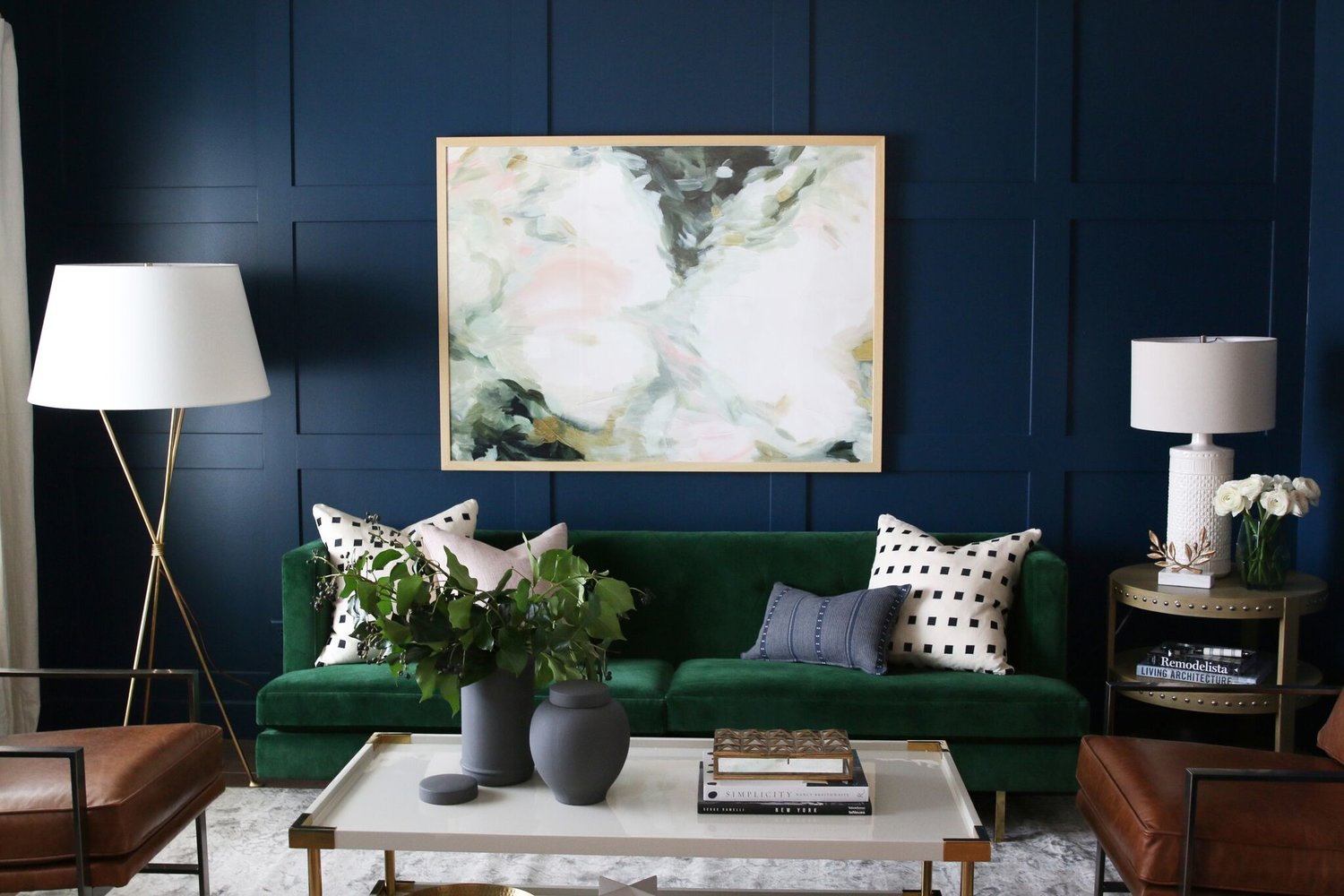 Green couch with white lamp next to it