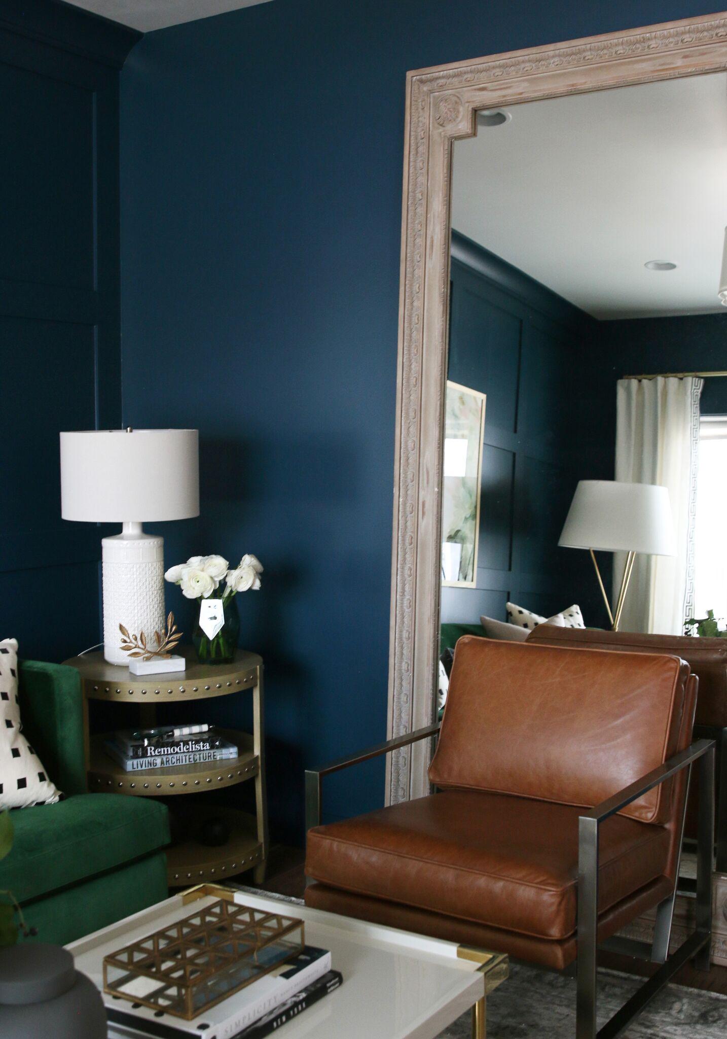 Brown chair in front floor length mirror