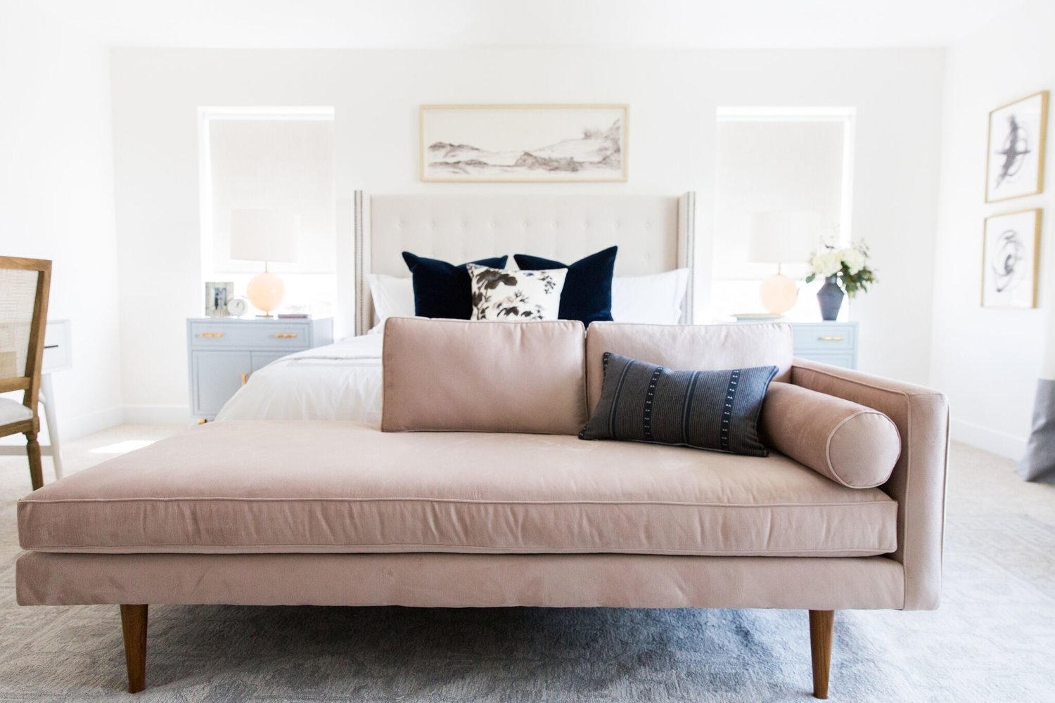 Light pink couch with pillows