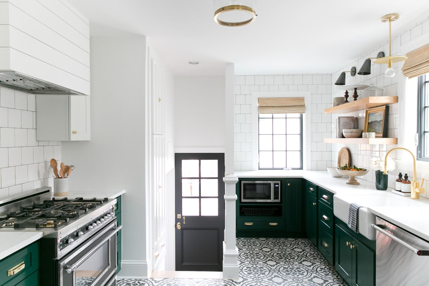 Kitchen entryway with black and white tile floor
