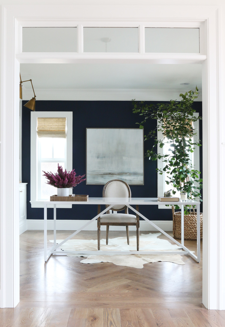 Modern and bold office with contrasting dark blue and white walls.