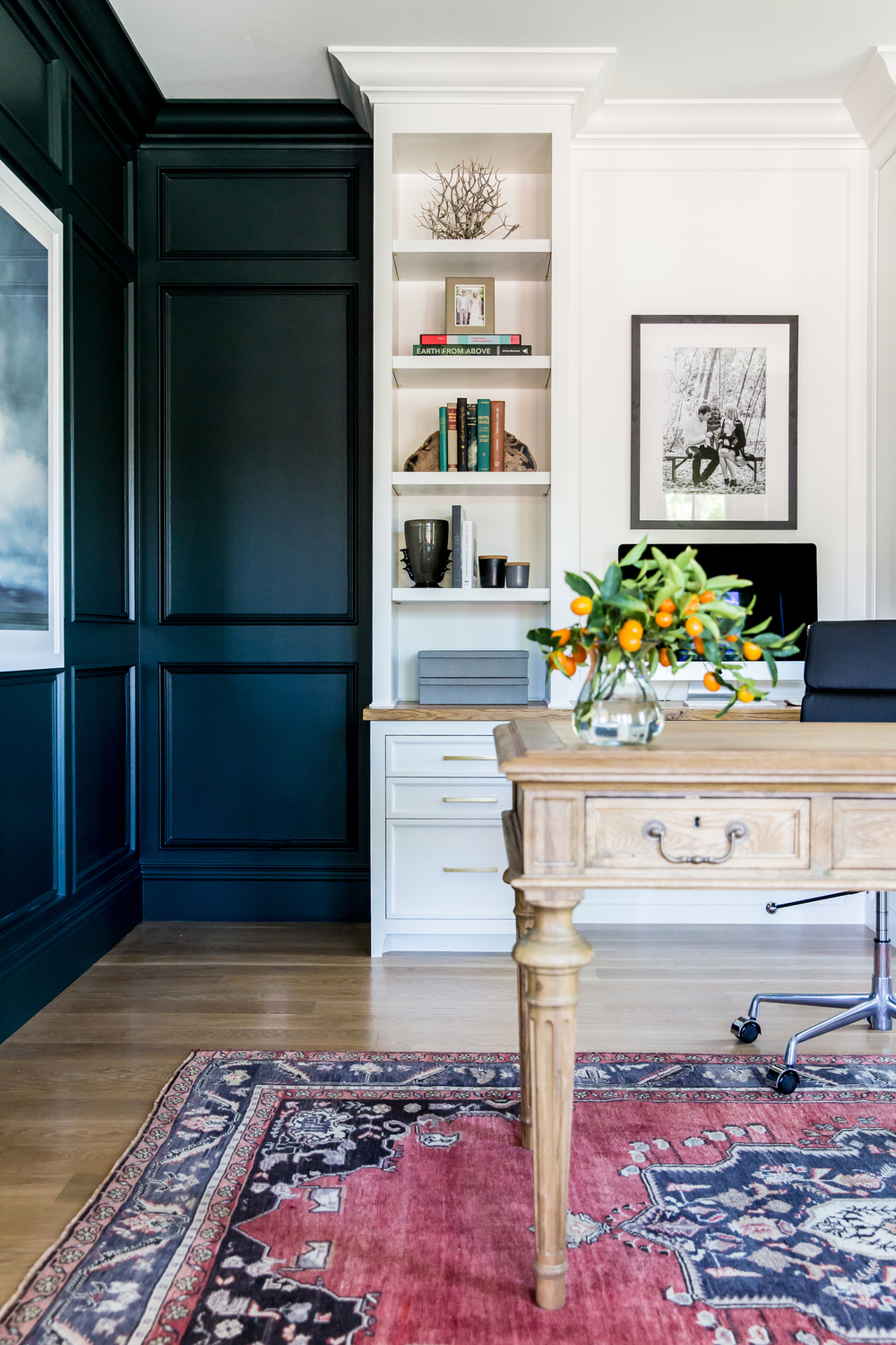 Modern office with bold color and built-in cabinets.