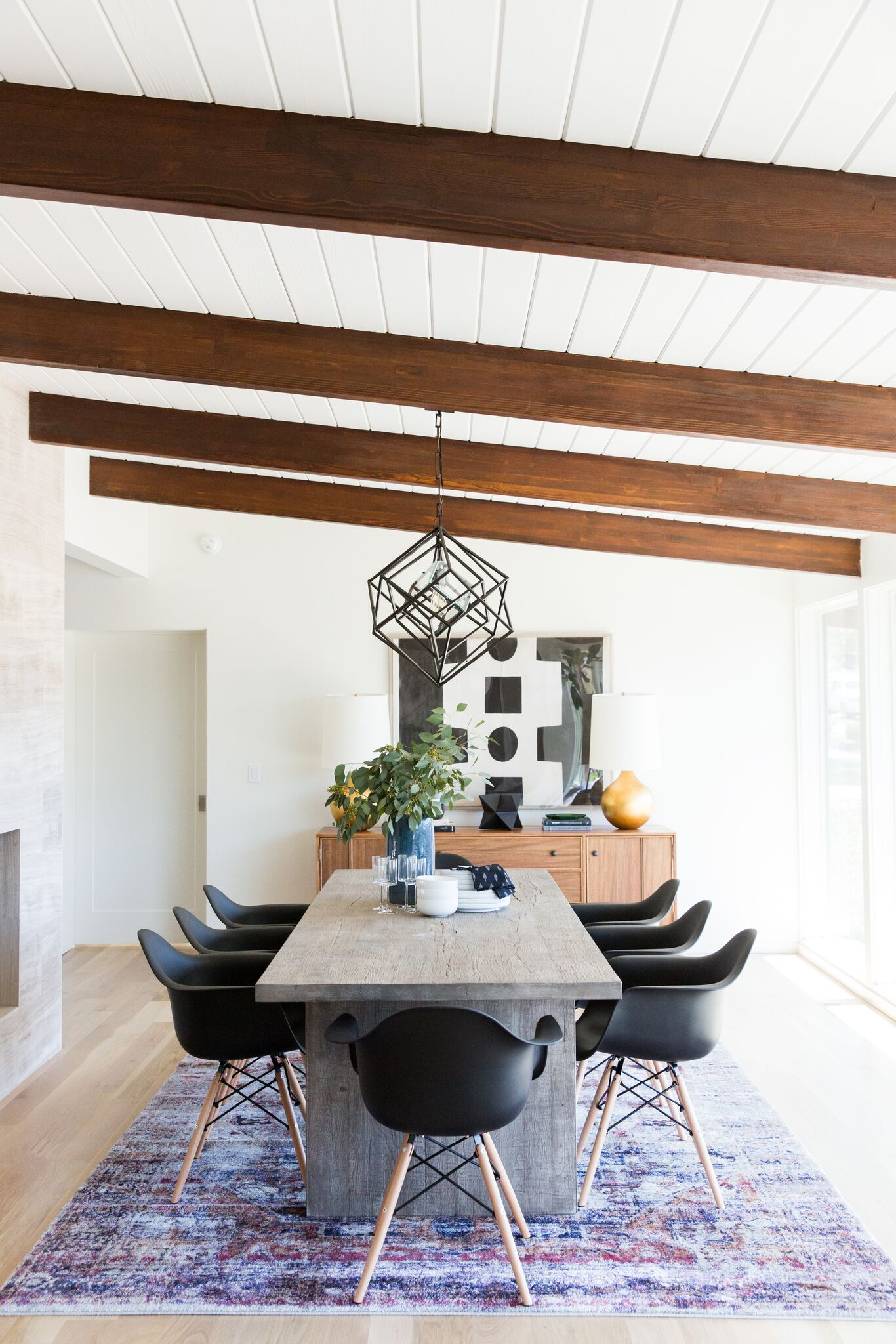 Long modern table with black  chairs
