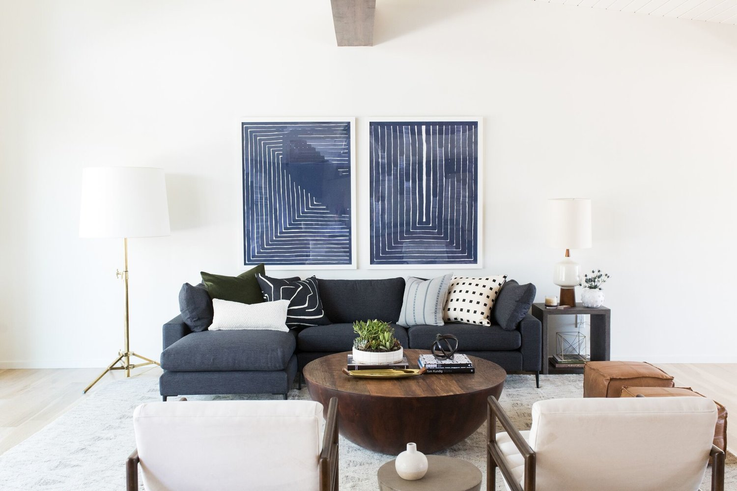 Renovated living room with dark navy couch