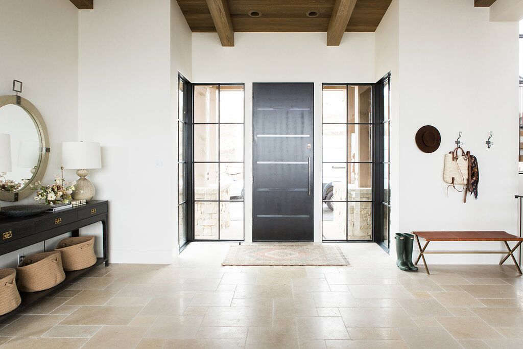 Modern mountain home tiled entry way with natural wood, and dark metals