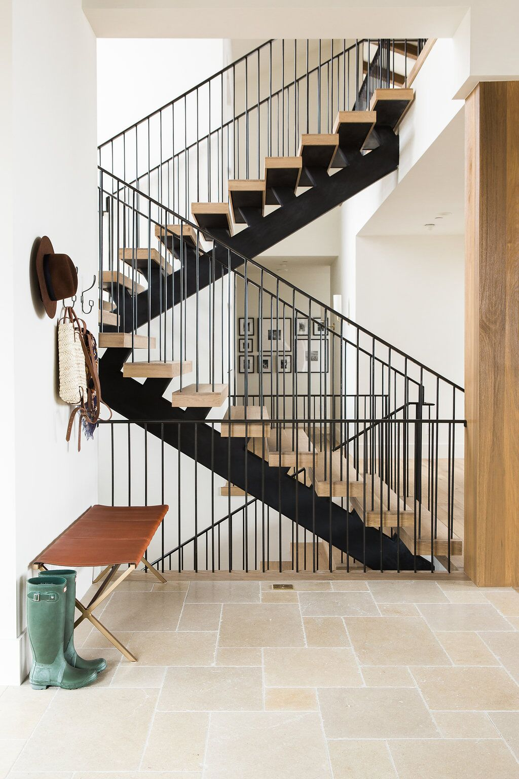 Modern staircase with dark metal and natural wood steps