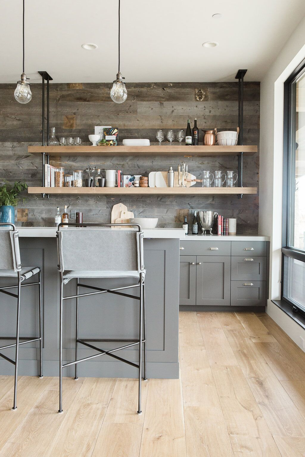Industrial designed wet bar with reclaimed wood and pipe shelving