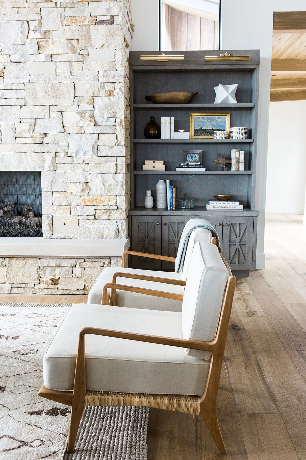 Side of two white chairs in living room