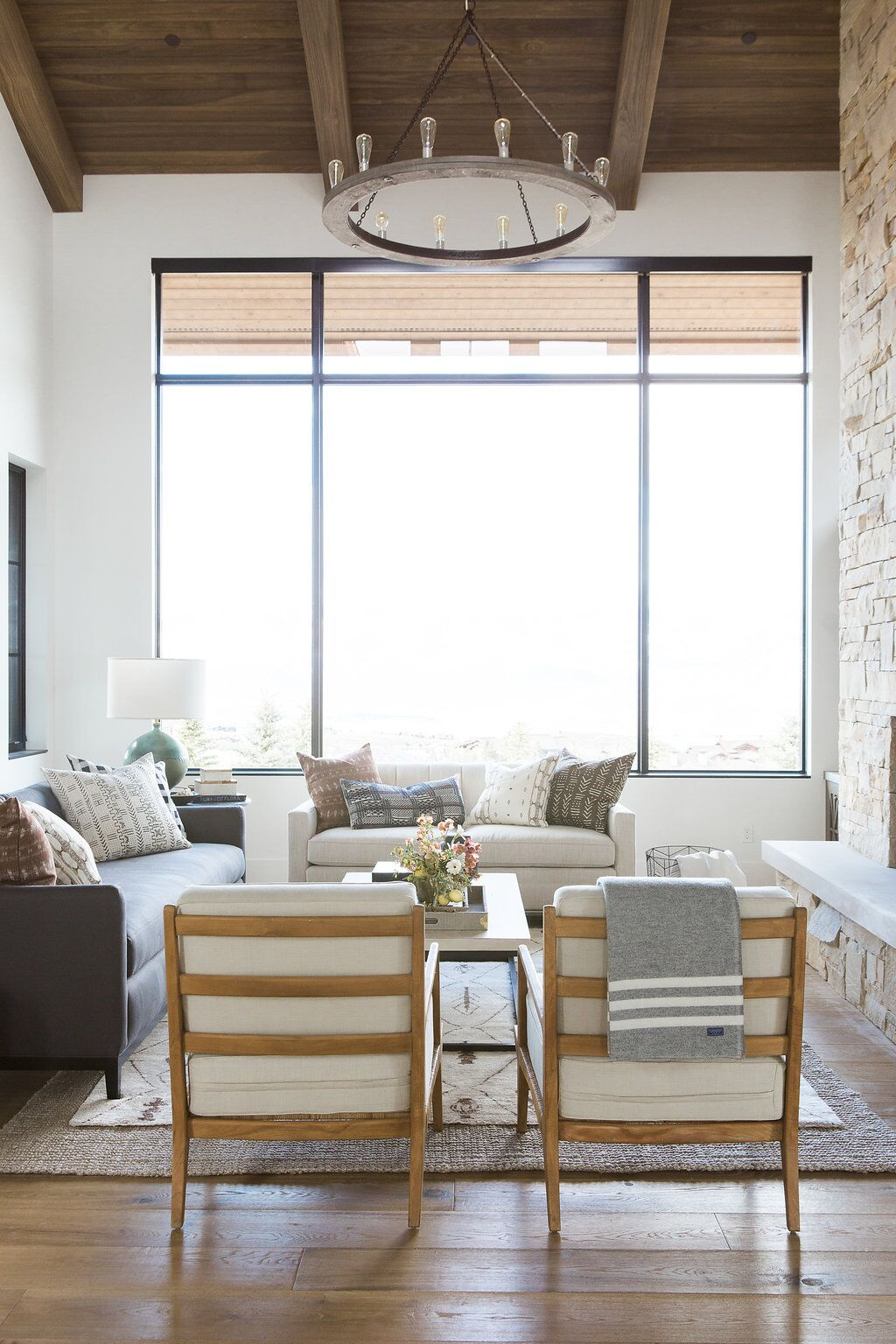 Back of two white chairs and living room window
