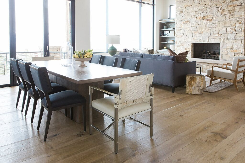 Long white table with grey chairs in dining room