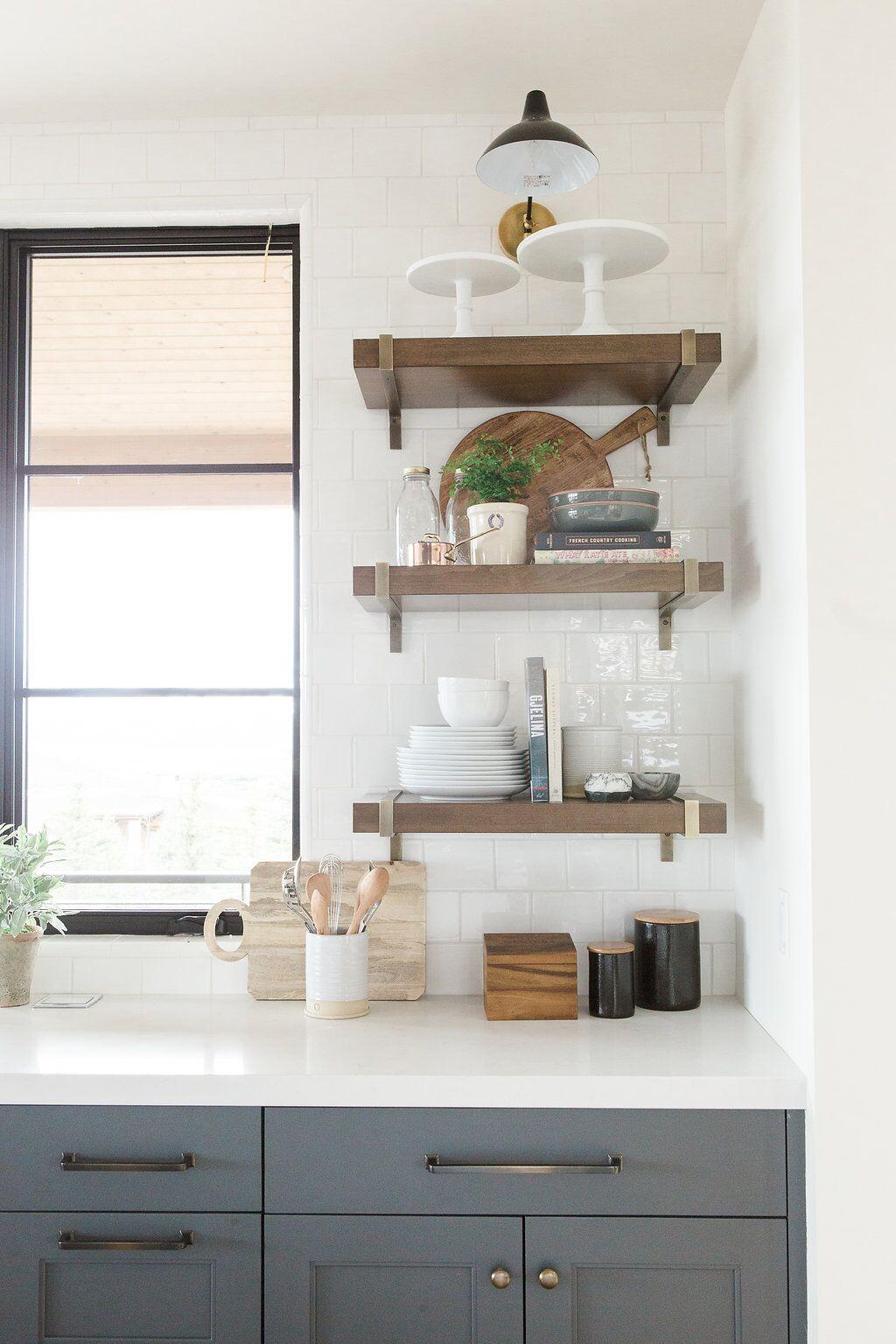 Built in wooden shelves along modern kitchen wall