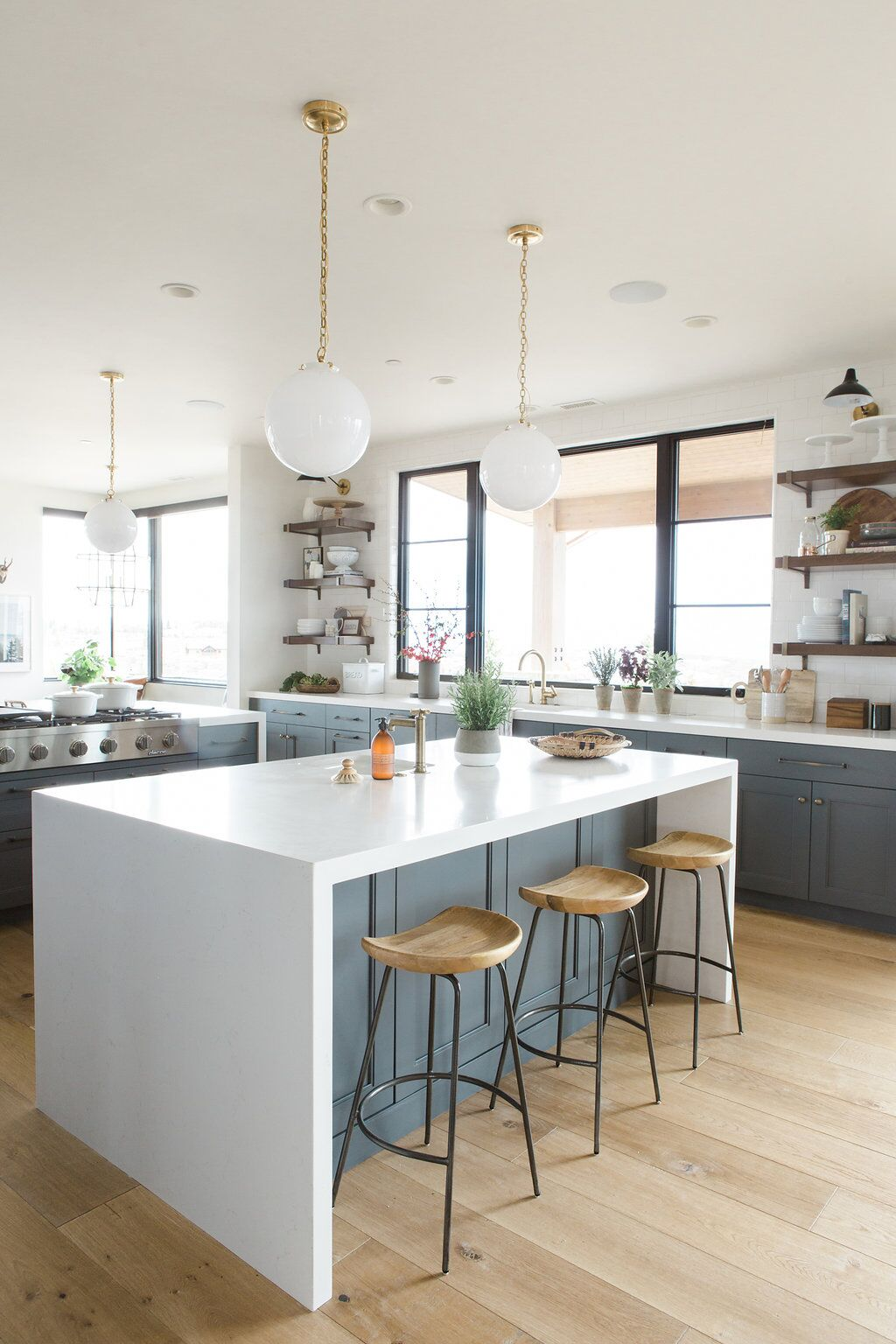 Grey kitchen island with white counter top