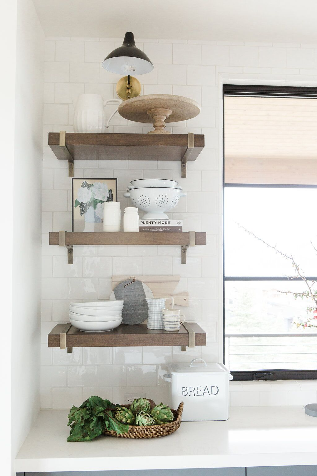 3 wooden built in shelves in modern kitchen