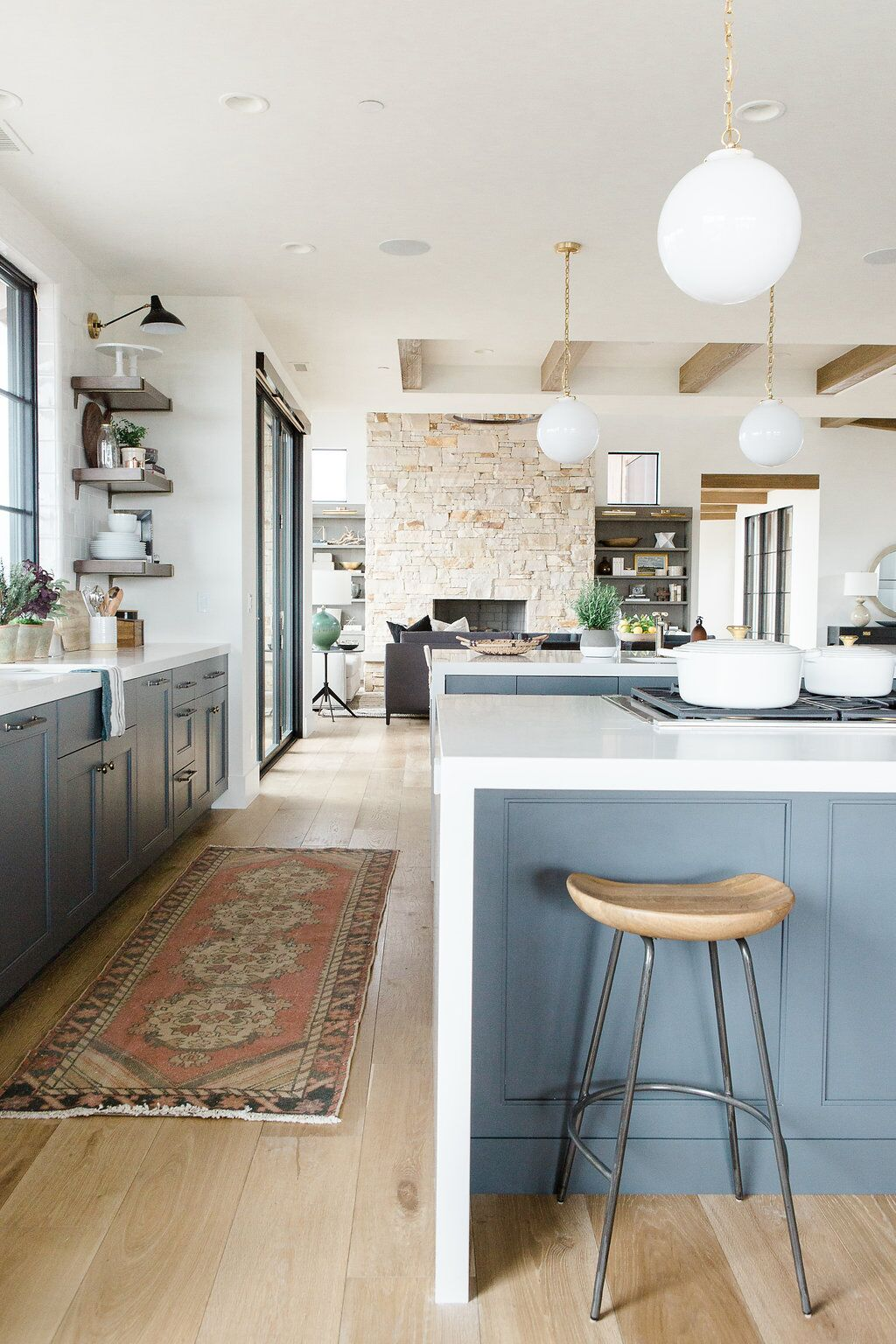wooden stool and woven rug details in kitchen