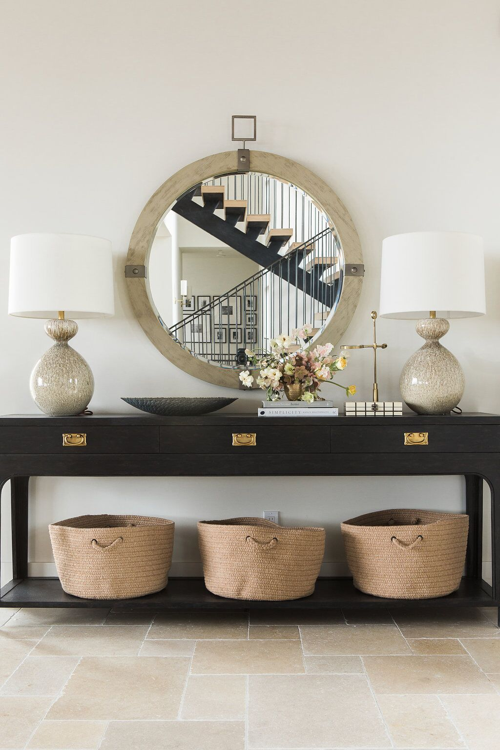 Dark wood table and mirror in entryway of home