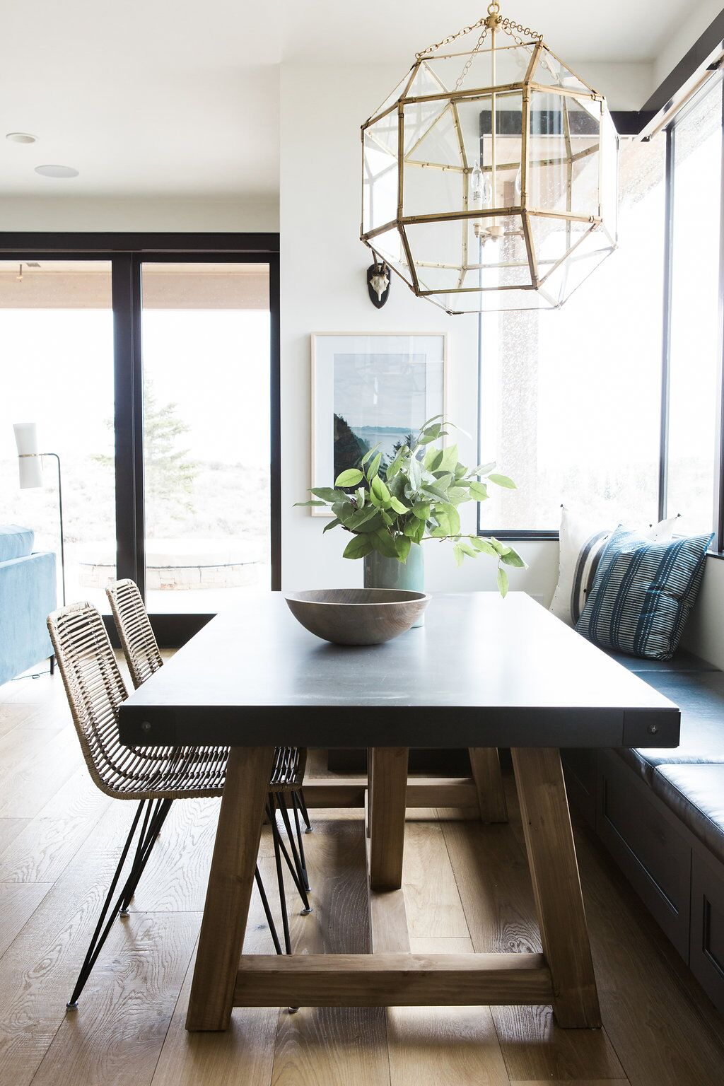 Length of kitchen table with sliding glass doors in background