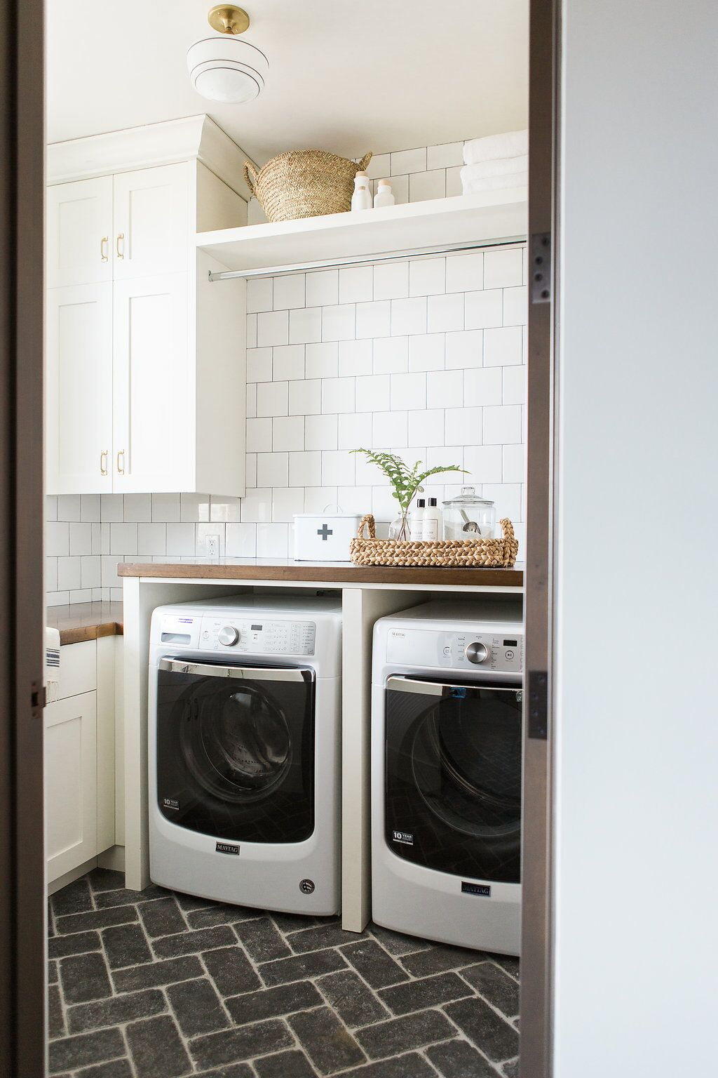 Washing room with grey tiled floor