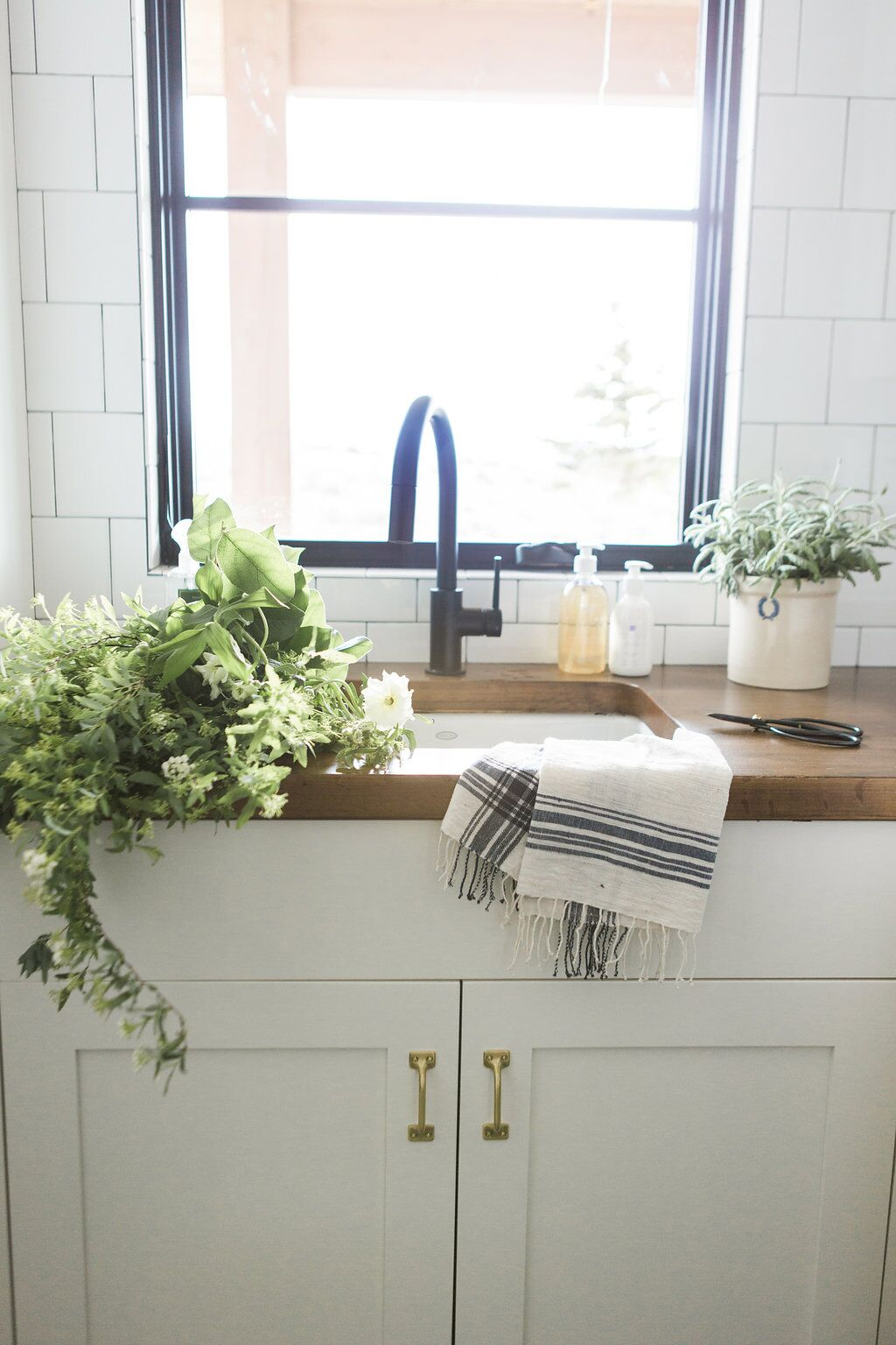 Large kitchen sink with wooden counter top