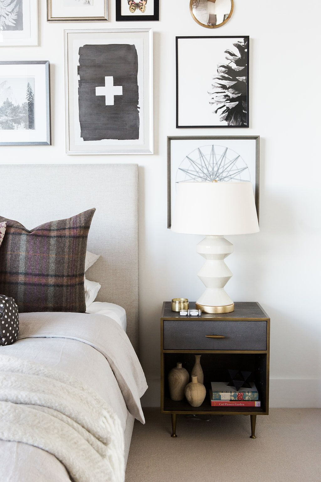 Small grey nightstand next to white bed