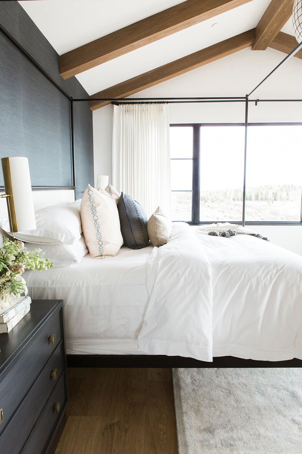 Side of bed against dark grey accent wall