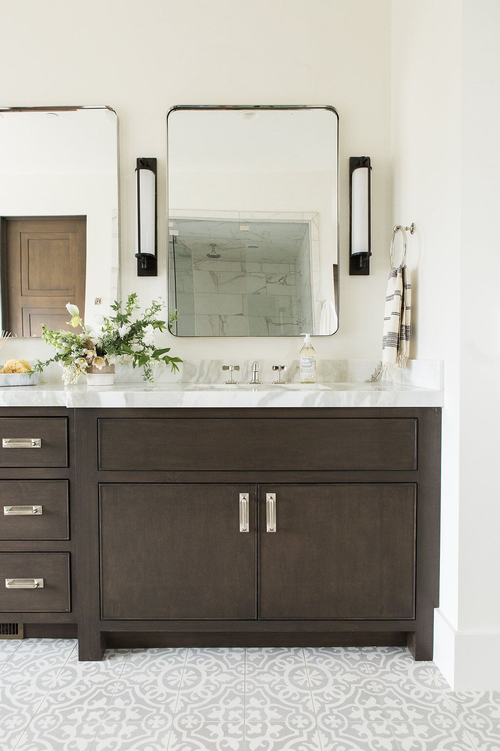 Vertical mirror hanging behind vanity sink
