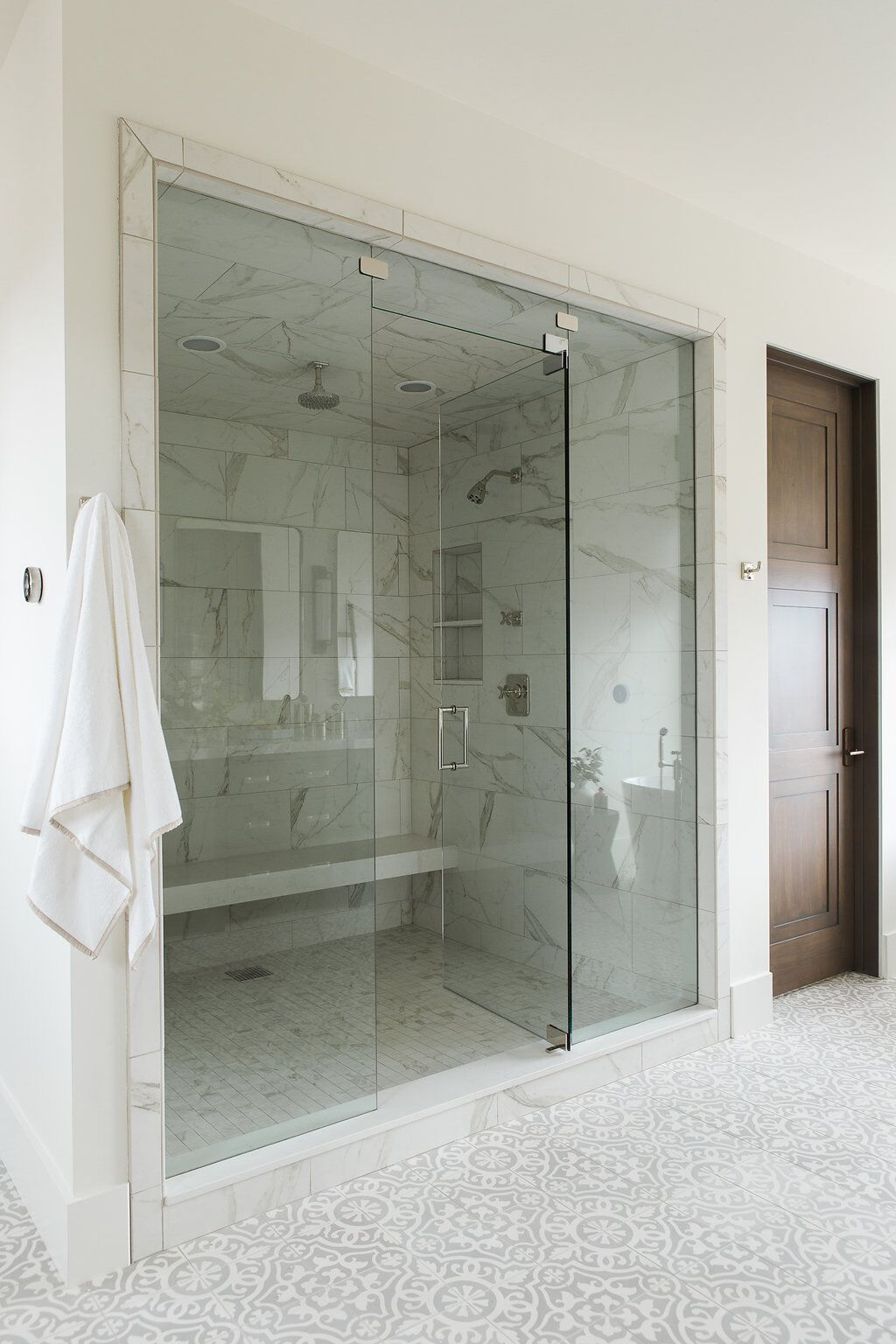 Large glass sliding door of stone shower
