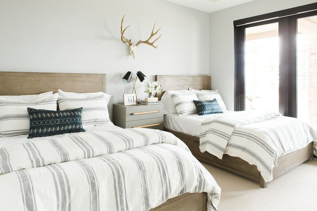 Double twin beds in white kids bedroom