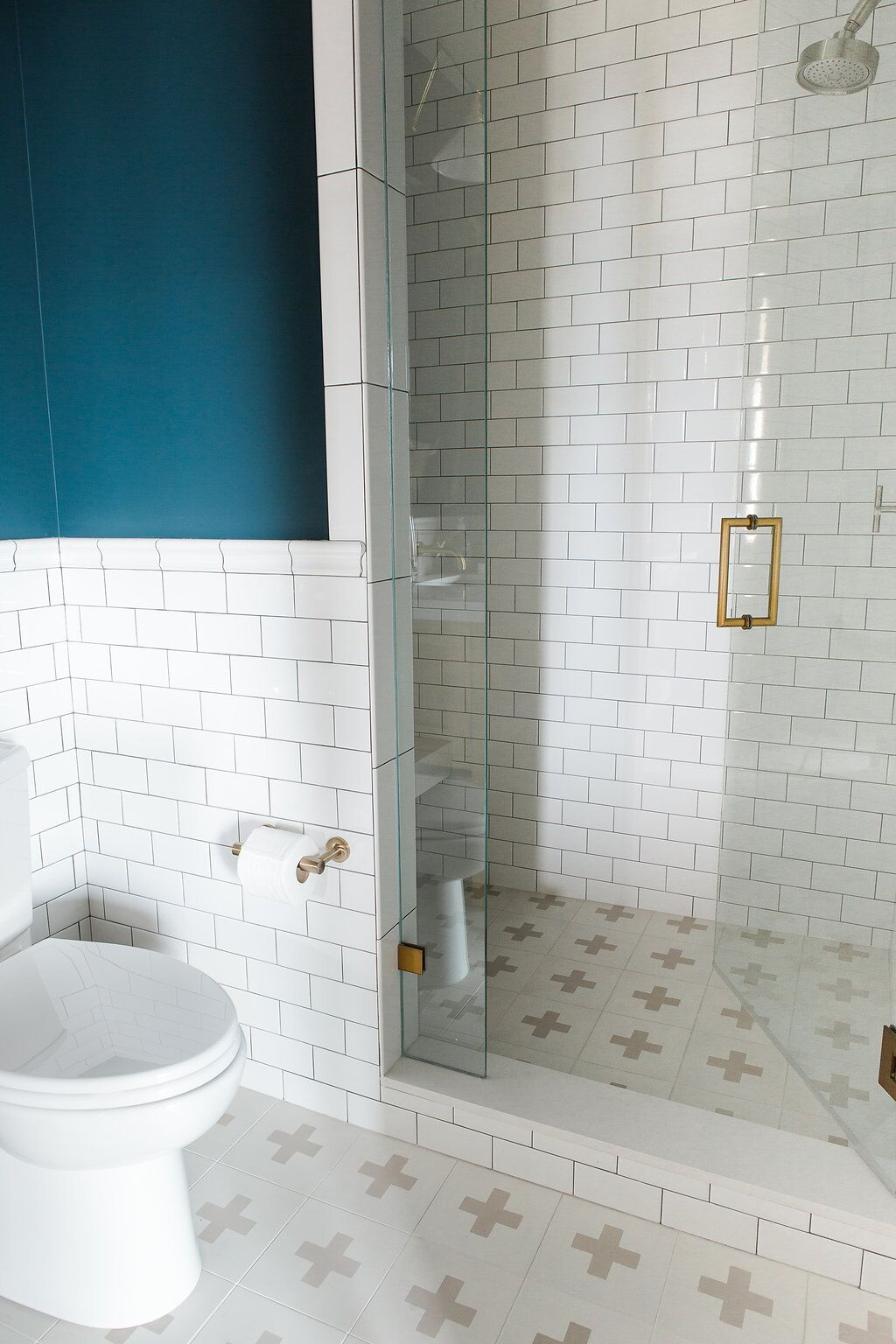 Sliding glass door of shower in kids bathroom