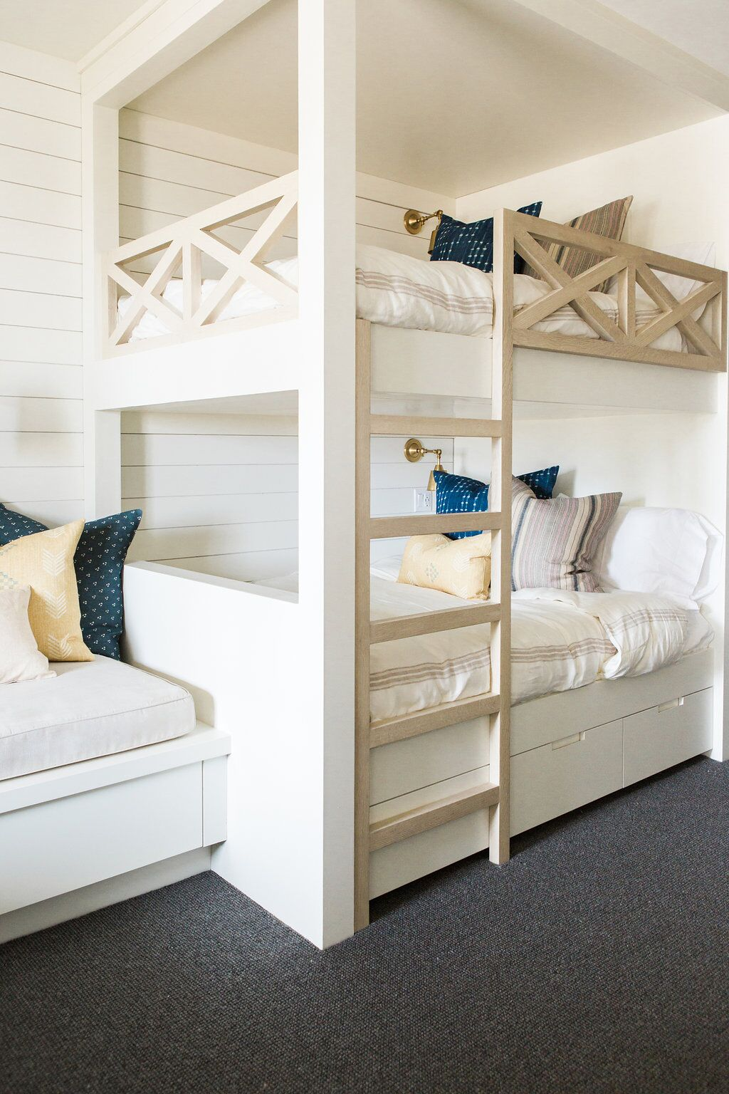 Built in twin bunk beds on grey carpet