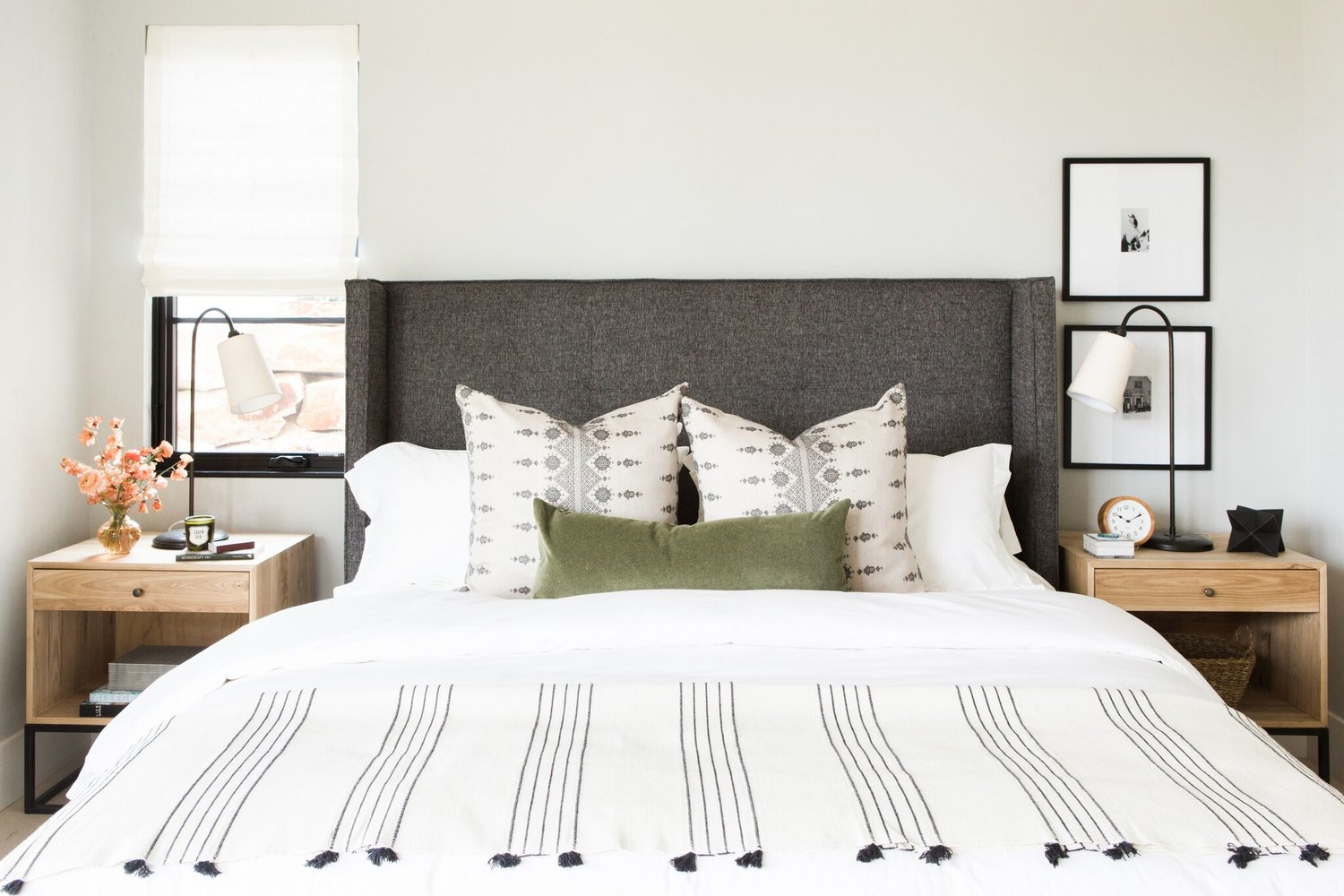 Large white bed with grey headboard