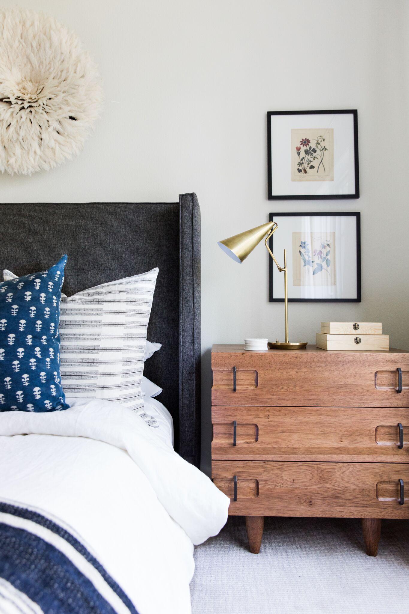 Coastal Bohemian Guest Bedroom with Vintage Rug and Botanical Prints