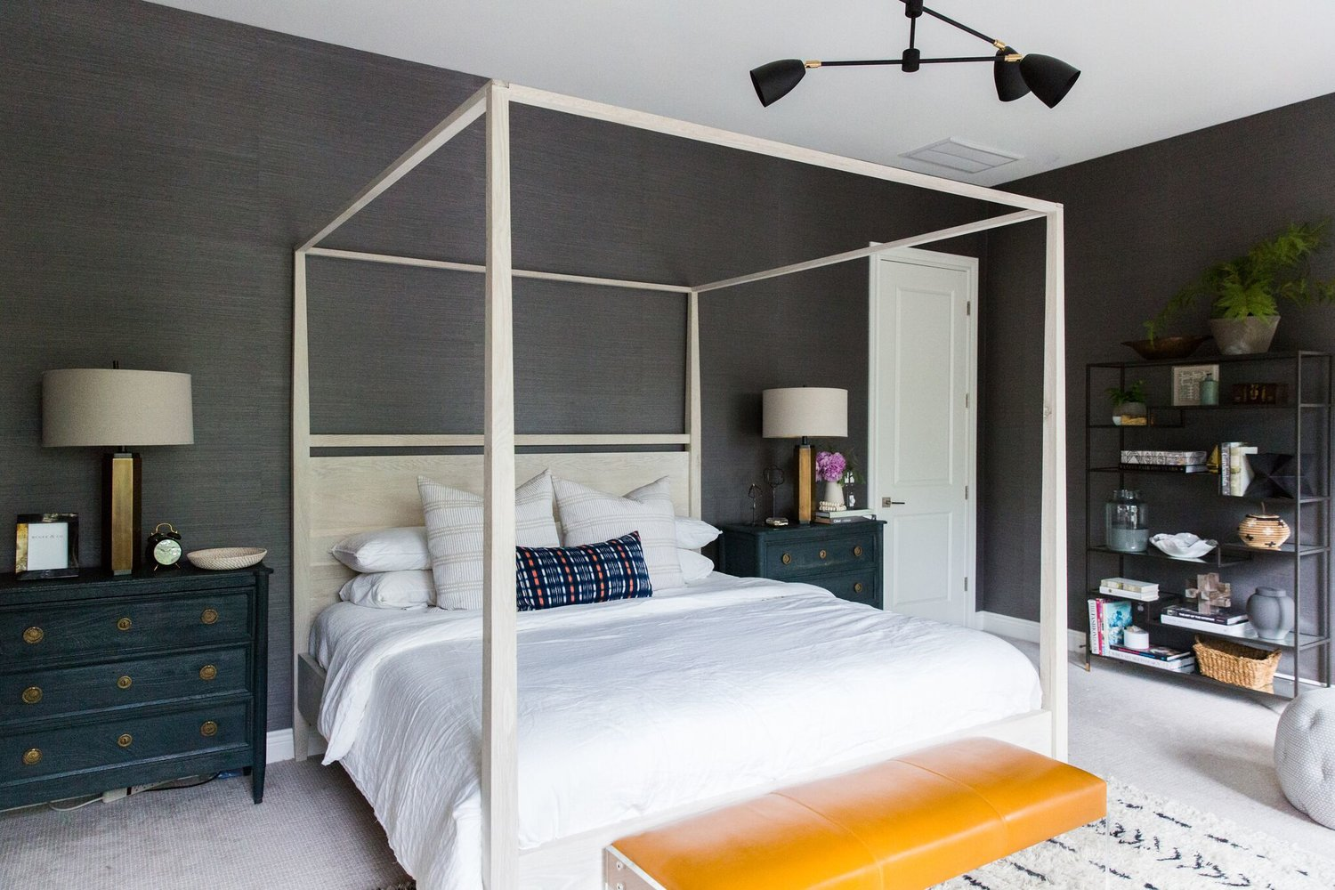 2Moody+Bohemian+Master+Bedroom+with+Dark+Grasscloth+Wallpaper,+Four+Poster+Bed,+and+Modern+Lighting.jpg