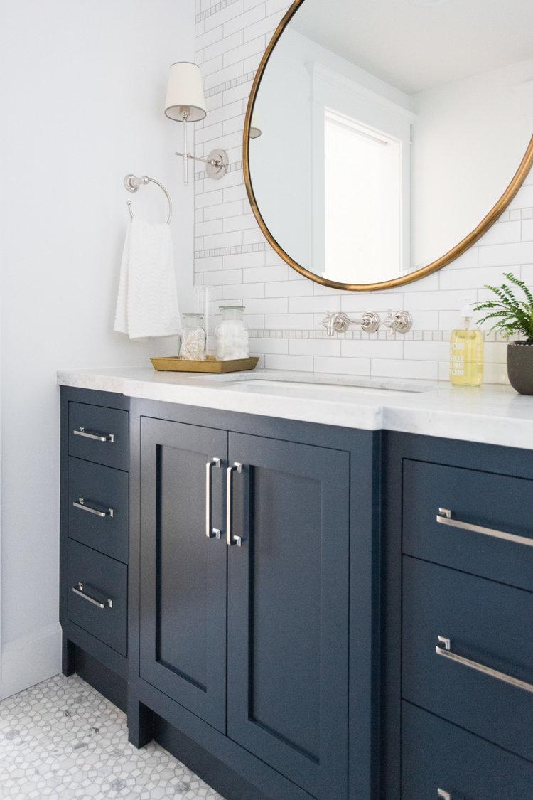 Marble+mosaic+floor+and+navy+cabinets+--+Studio+McGee.jpg