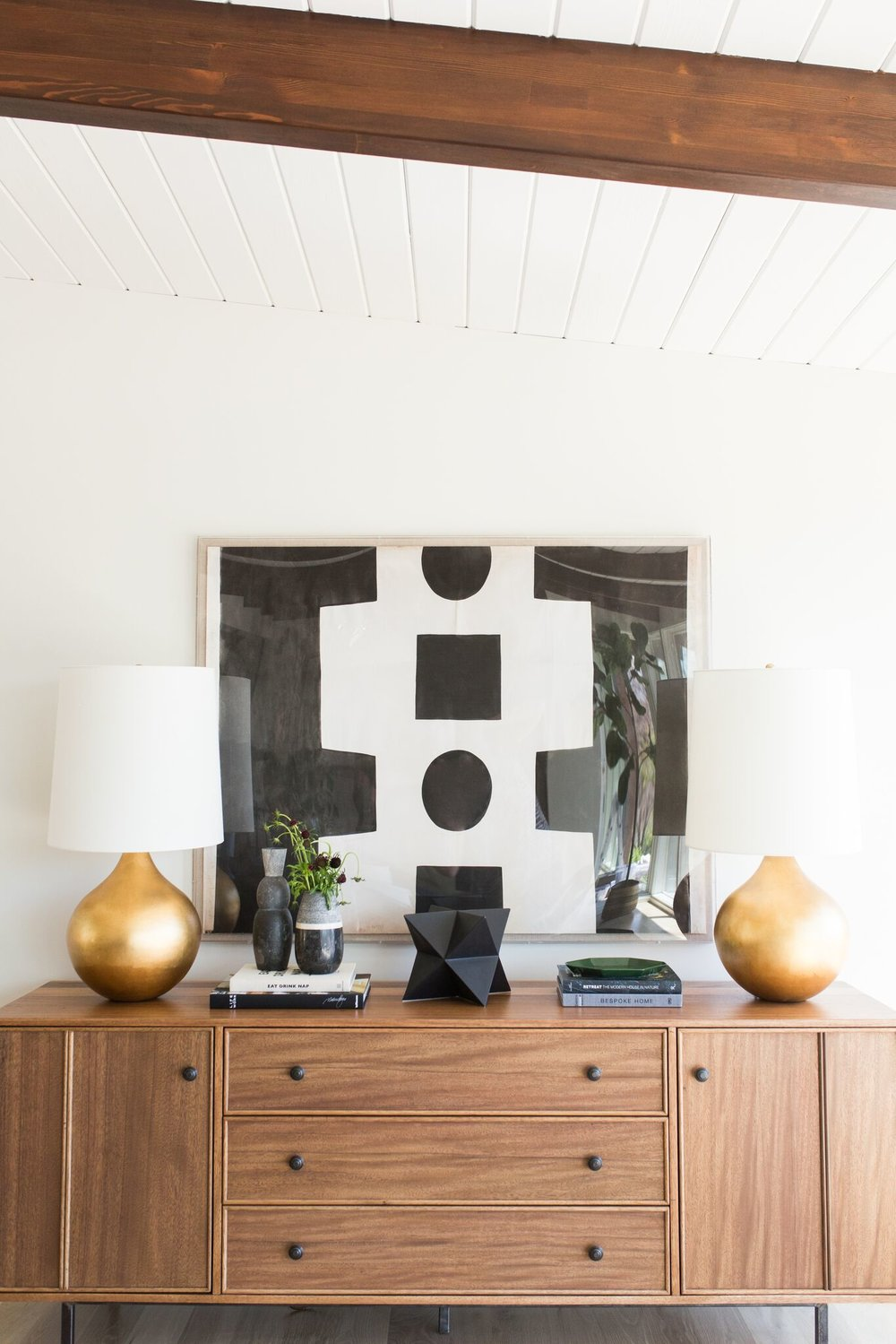 20Mid-Century+Home+with+Modern+Artwork+and+Natural+Wood+Cabinet.jpg