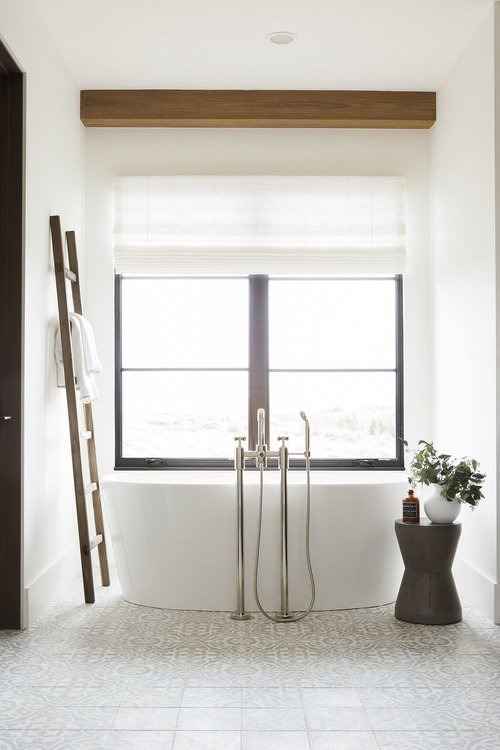 37Master+bathroom+with+concrete+tile,+free+standing+tub,+and+walk+in+shower.jpg