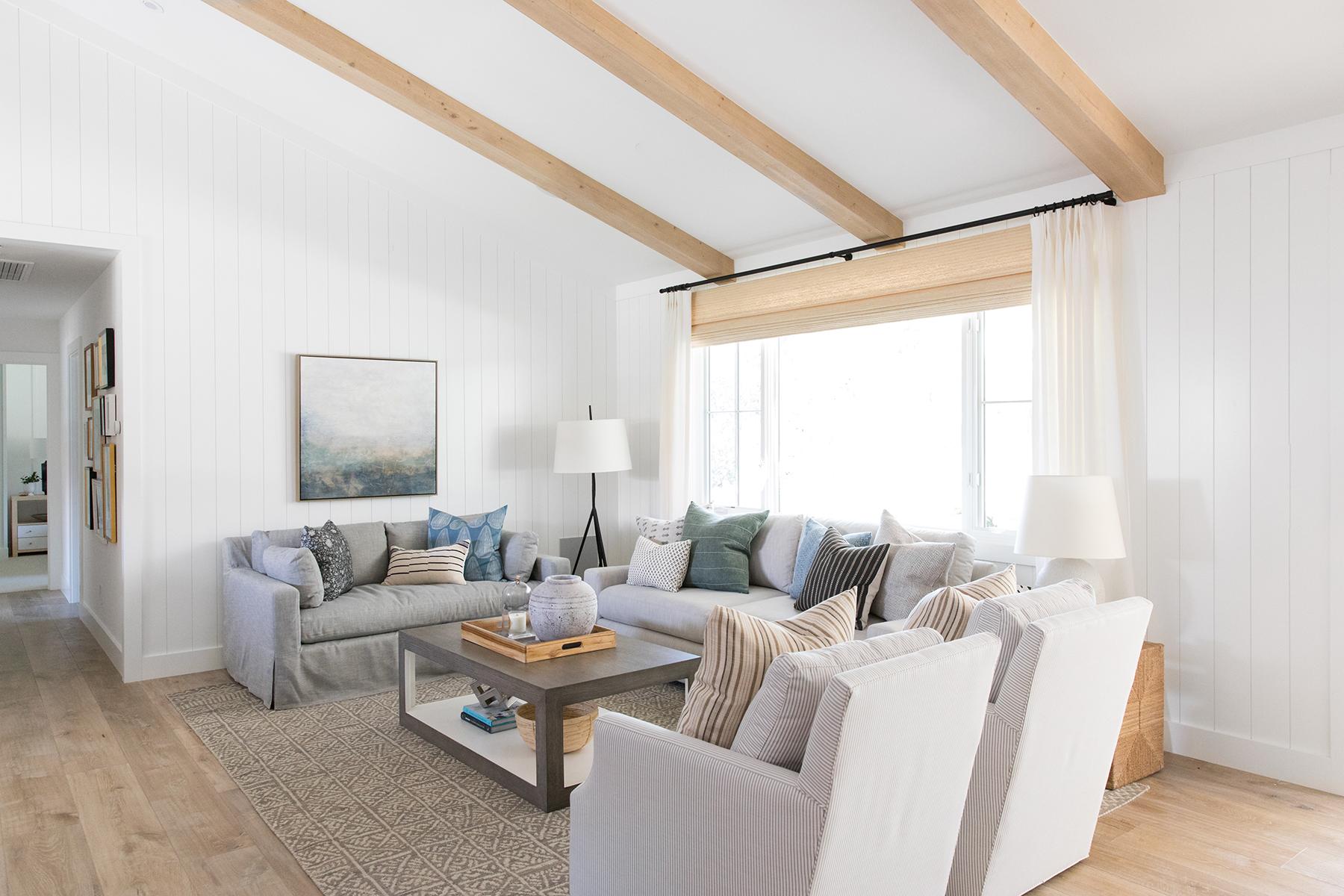 Moody Coastal Living Room with exposed beams - Studio McGee.jpg