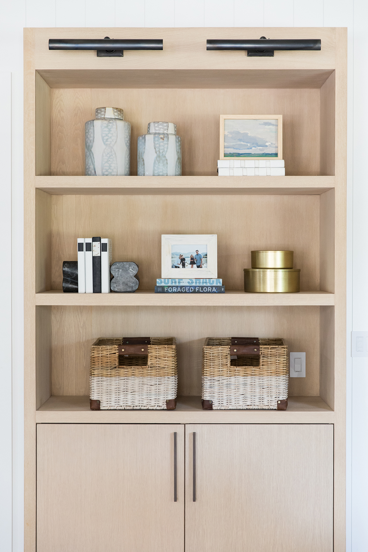 Natural wood shelf styling in the living room - Studio McGee