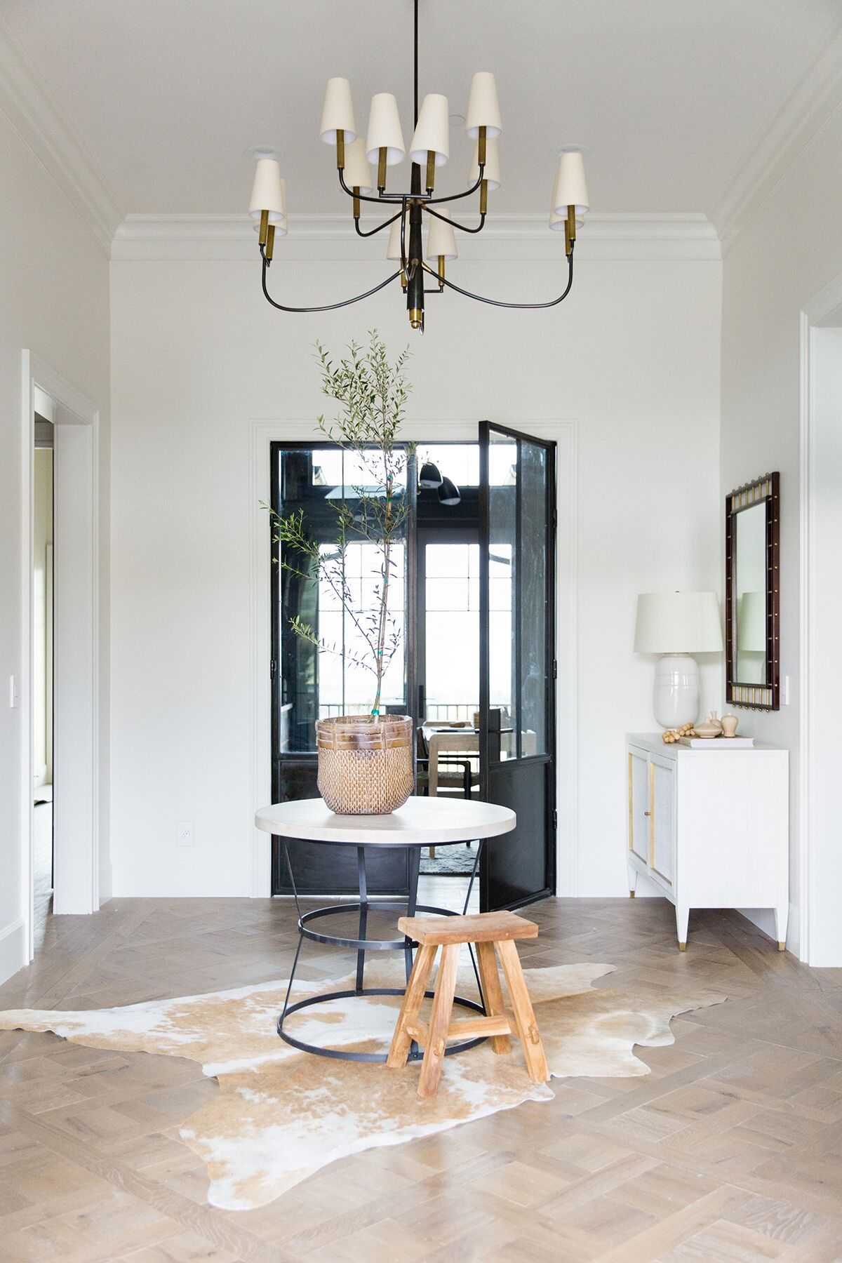 Clean, rustic entryway with custom flooring in a mountain home in Park City, Utah - Studio McGee Design