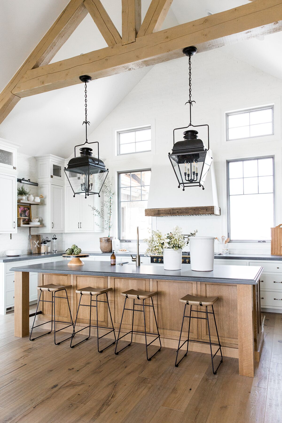 Refined,+rustic+kitchen+with+exposed+wooden+beams,+hanging+lanterns,+painted+white+brick,+oven+range+in+mountain+home+-+Studio+McGee+Design-1.jpg