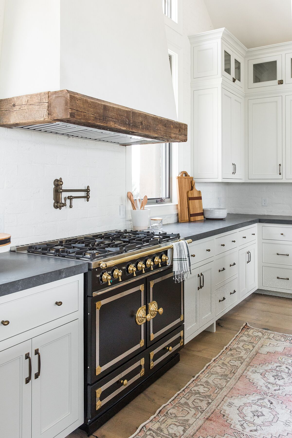 Refined,+rustic+kitchen+with+exposed+wooden+beams,+hanging+lanterns,+painted+white+brick,+oven+range+in+mountain+home+-+Studio+McGee+Design-5.jpg