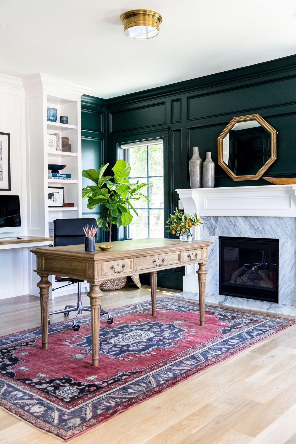 Green-black+paneled+walls+and+marble+fireplace+__+Studio+McGee.jpg