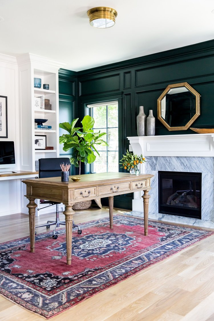 How to Add Character to Your Kitchen Walls - Wall Moulding in Green-black+paneled+walls+and+marble+fireplace