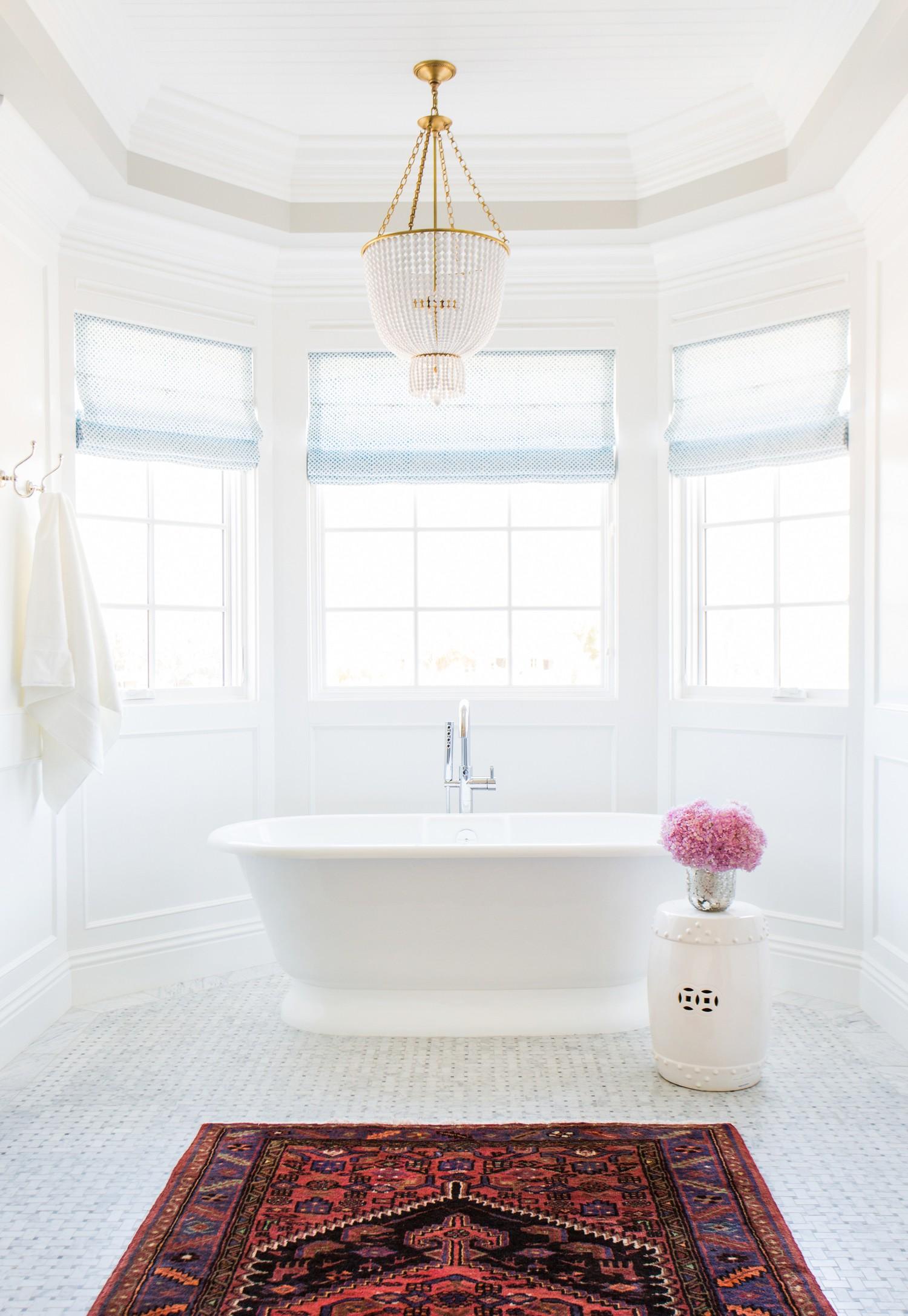 Marble+basketweave+tile,+Persian+Rug+in+the+bathroom+and+chandelier+over+tub+__+Studio+McGee.jpg