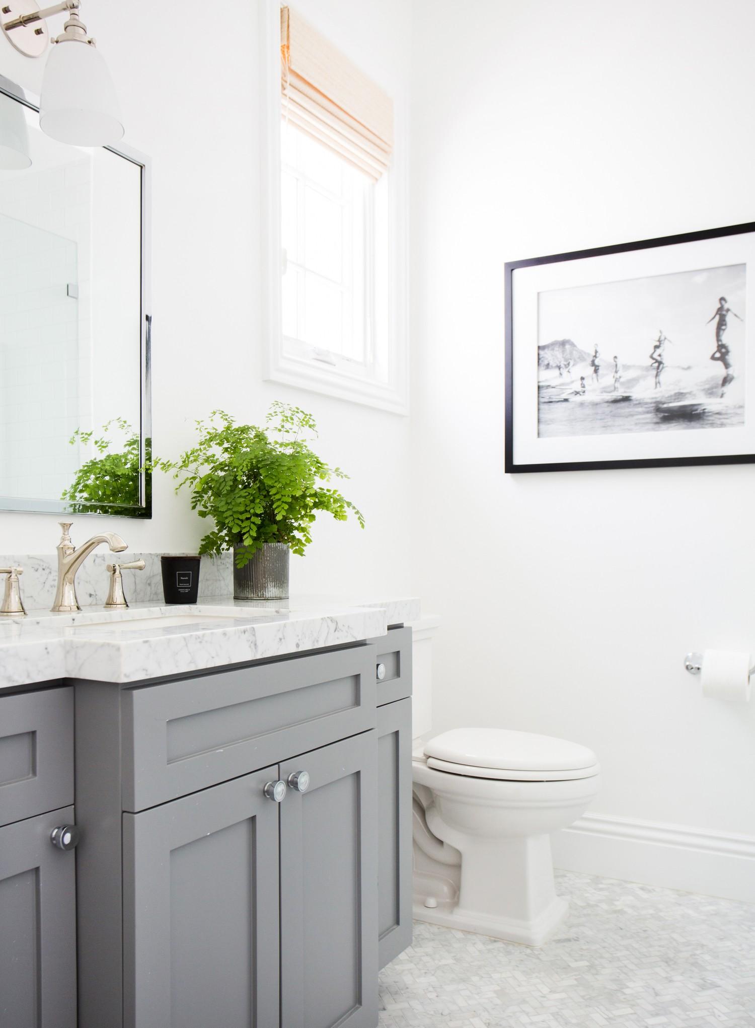 Bathroom with Benjamin Moore 'Chelsea Gray' vanity and B/W artwork || Studio McGee