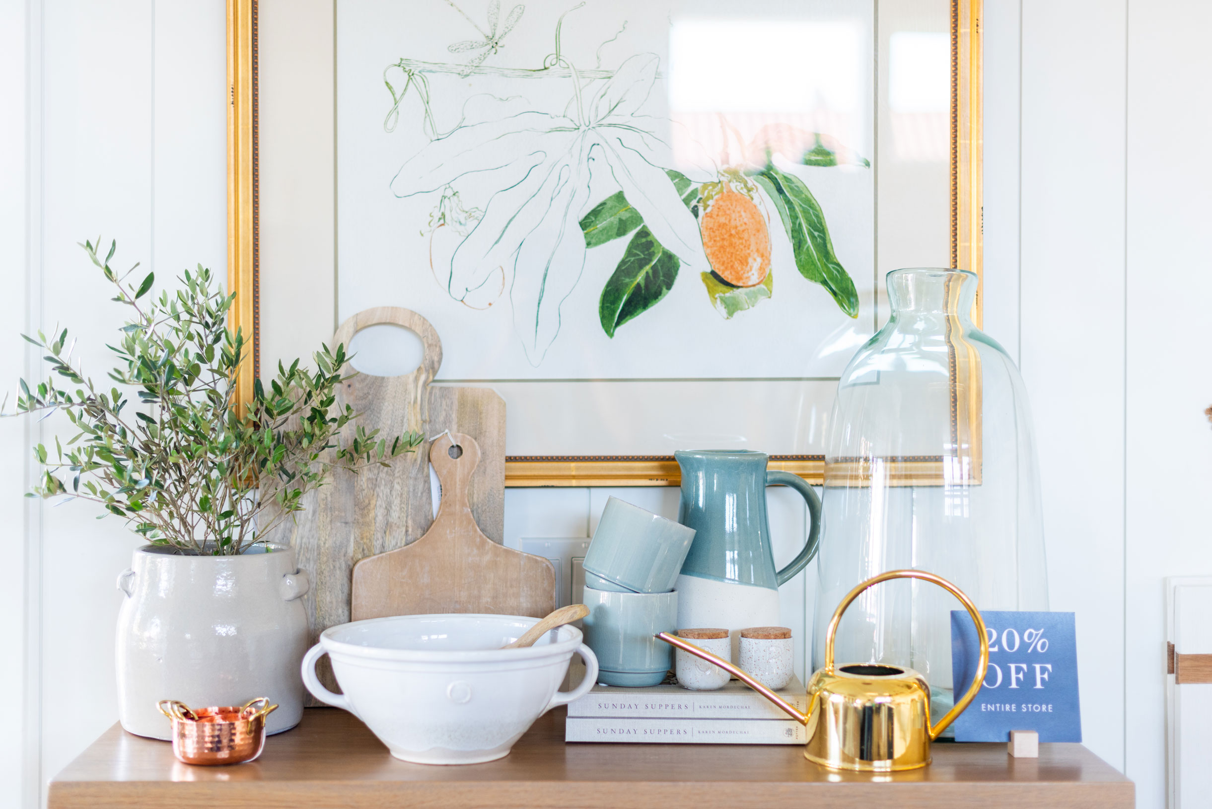 Products shown:    Mango Wood Bread Board,       Short Cutting Boards   ,    Gold Watering Can   ,    Zina Pot   ,    Salt & Pepper Cellar Salt    ,    Green Dipped Pitcher   ,    Copper Measuring Cups